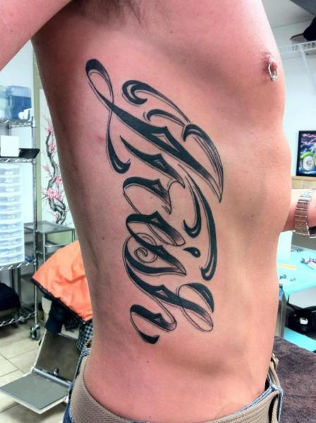 Side Lettering Fonts Tattoo by Sakura Tattoos