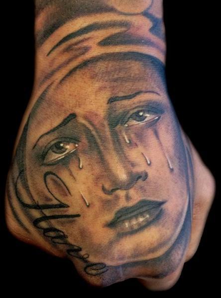 Realistic Women Hand Tattoo by Club Tattoo