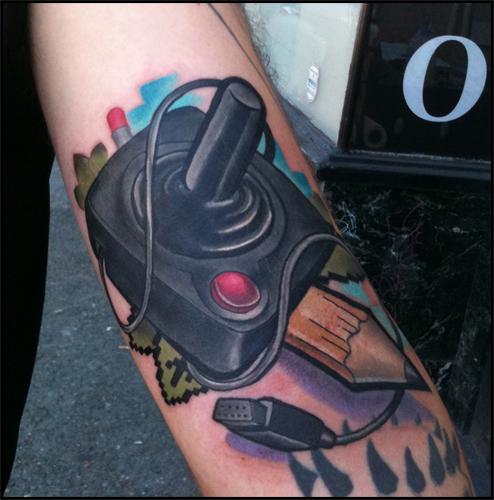 Arm Joystick Tattoo by Scott Falbo