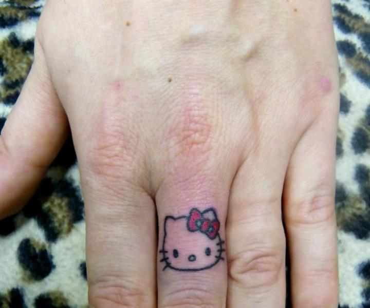 Finger Hello Kitty Tattoo by Bubblegum Art