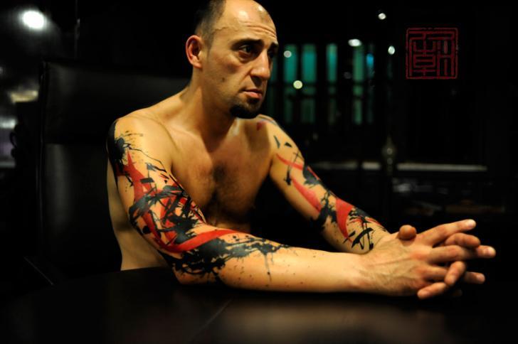 Arm Trash Polka Tattoo by Tattoo Temple