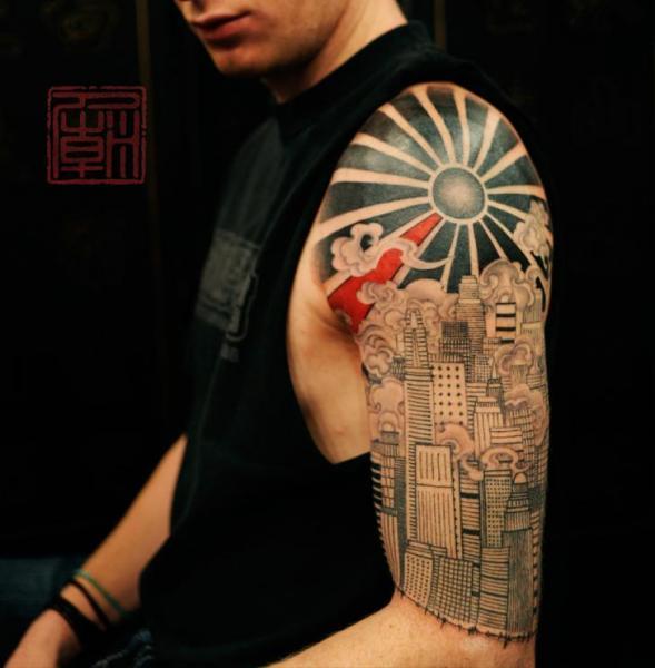 Tatouage Epaule Paysage Soleil Ville Par Tattoo Temple