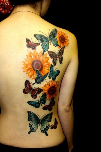 Flower Back Butterfly Tattoo by South Dragon Tattoo