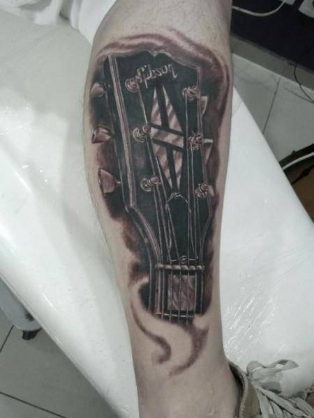 Arm Realistic Guitar Tattoo by Tattoo Br