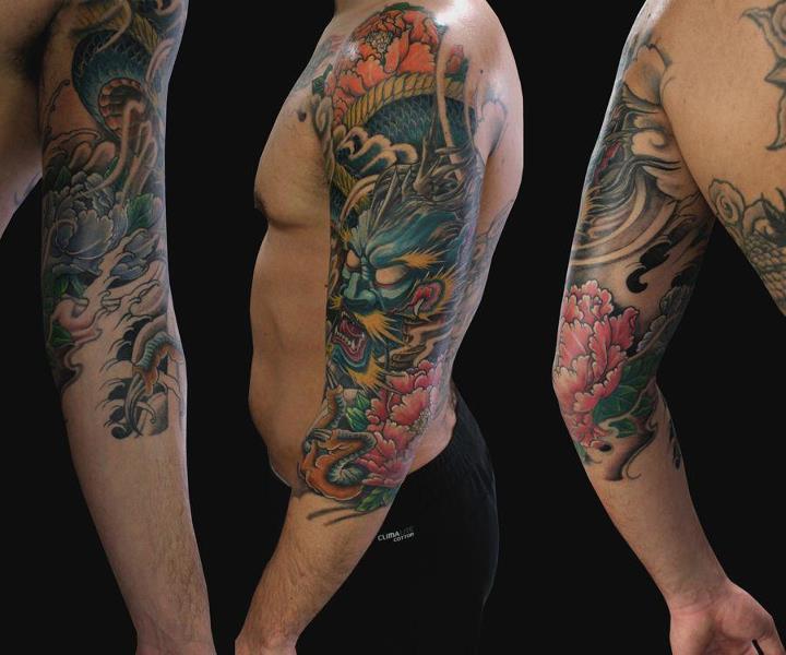 Tatuaje Brazo Dragón por Nico Tattoo Crew