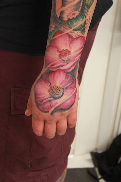Realistic Flower Hand Tattoo by Nico Tattoo Crew