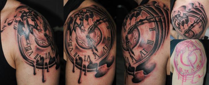 Shoulder Clock Tattoo by Medusa Tattoo