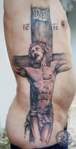 Side Religious Crux Tattoo by Medusa Tattoo