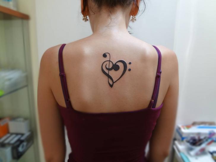 Heart Back Music Tattoo by Tattoo Stingray