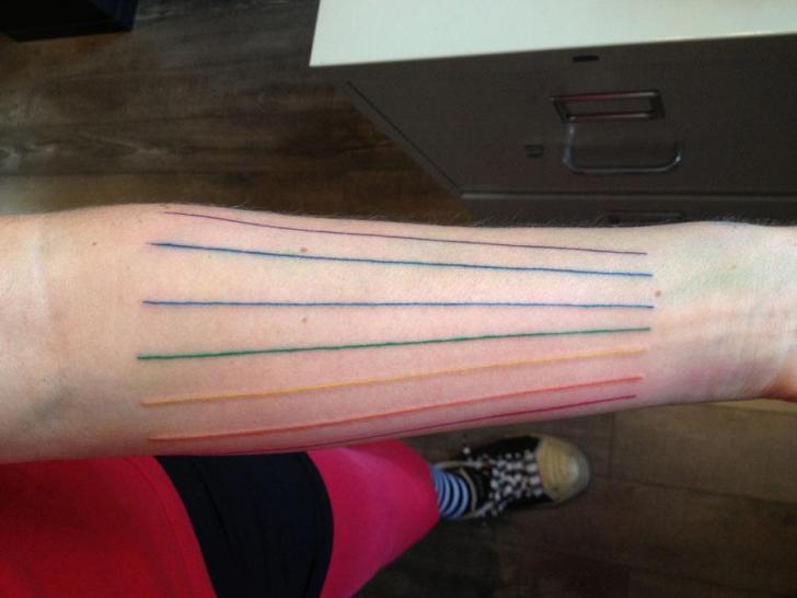 Tatuaggio Braccio Linea di Rainfire Tattoo