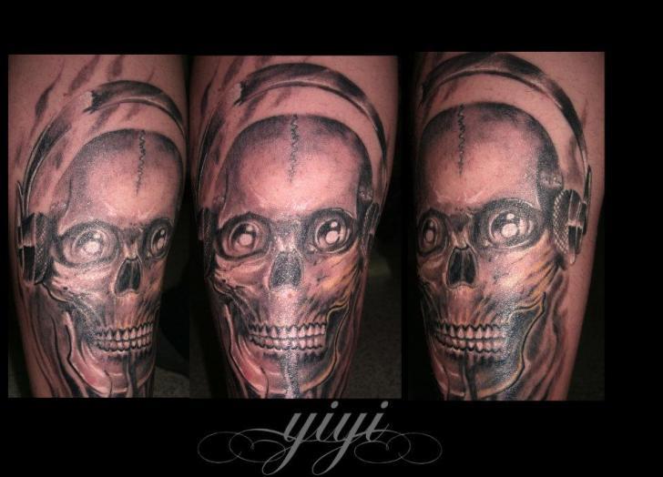 Arm Skull Headphones Tattoo by Inkfierno Tattoo