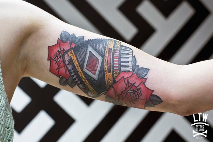 Arm Old School Accordion Tattoo by LW Tattoo