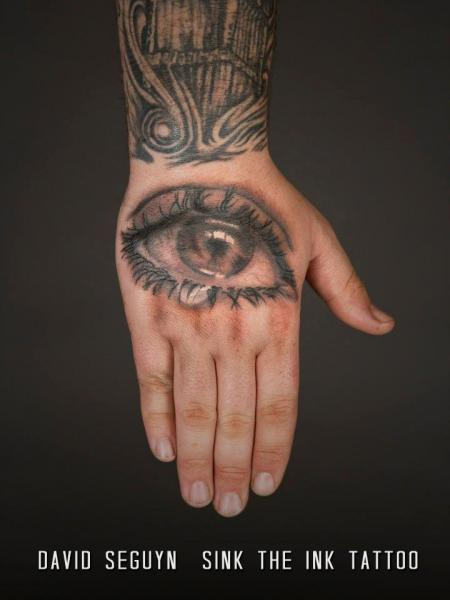 Realistic Hand Eye Tattoo by Sink The Ink