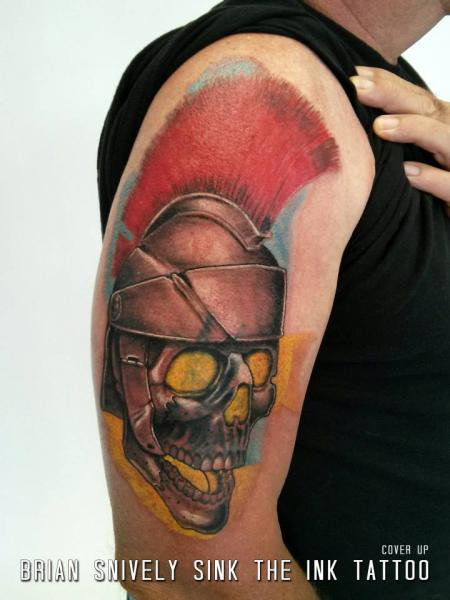 Shoulder Skull Helmet Tattoo by Sink The Ink