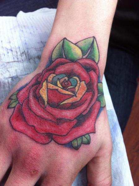 Flower Hand Rose Tattoo by Sink Candy Tattoo