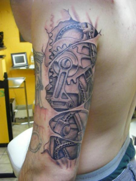 Arm Biomechanical Tattoo by Sonic Tattoo
