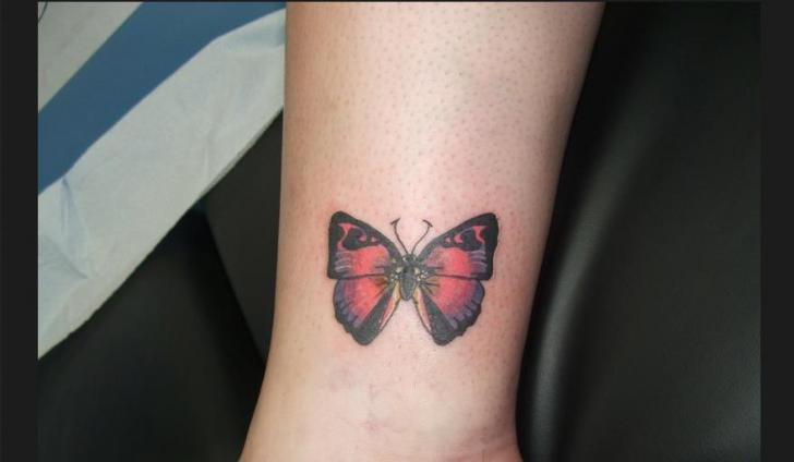 Arm Butterfly Tattoo by Sonic Tattoo