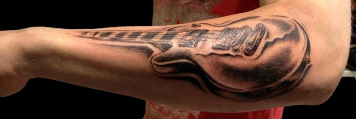 Arm Realistic Guitar Tattoo by Cactus Tattoo