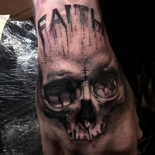 Skull Hand Tattoo by Art Line Tattoo