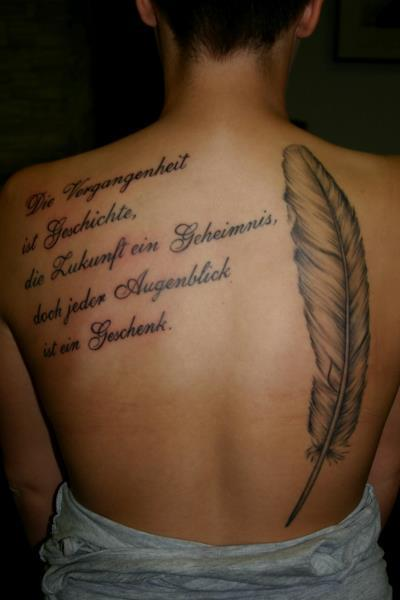 Feather Lettering Back Tattoo by Corpus Del Ars