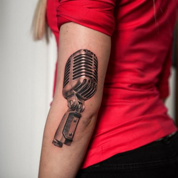 Arm Realistic Microphone Tattoo by Wicked Tattoo