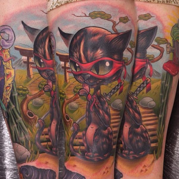 Arm Fantasy Cat Character Tattoo by Nemesis Tattoo