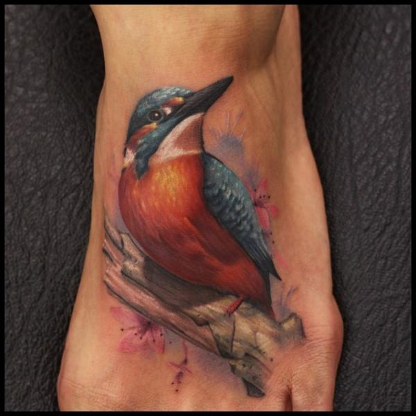 Realistic Foot Bird Tattoo by Nemesis Tattoo