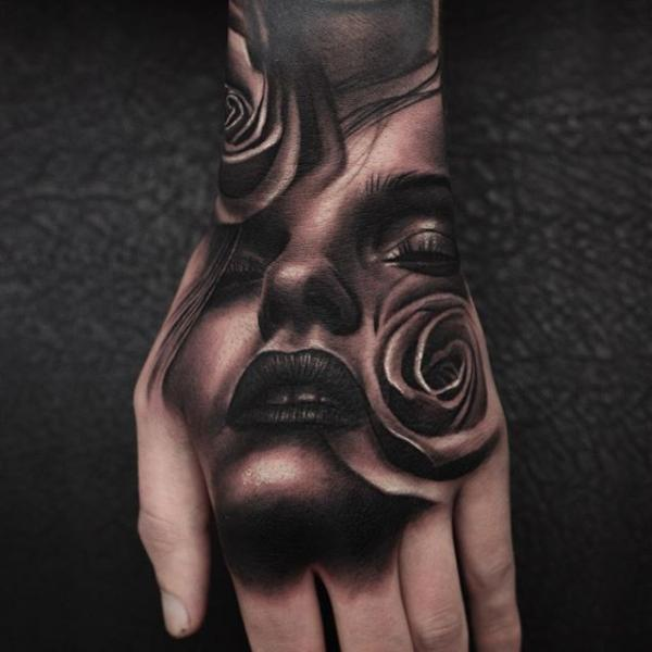 Hand Rose Woman Tattoo by Nemesis Tattoo