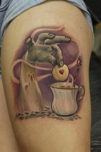 Shoulder Fantasy Hand Cake Tattoo by Nemesis Tattoo