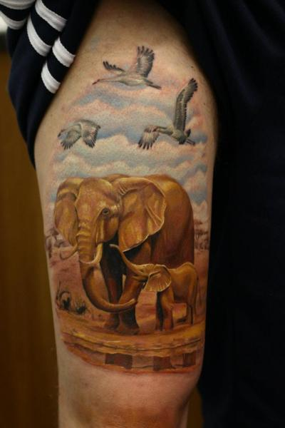 Realistic Elephant Thigh Tattoo by Nemesis Tattoo