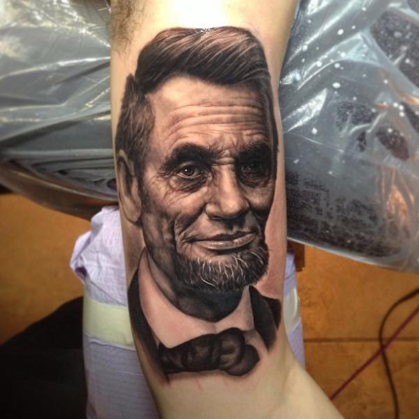 Arm Realistic Lincoln Tattoo by Steve Wimmer