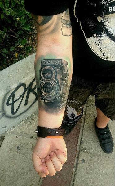 Arm Realistic Camera Tattoo by Tattoo Ligans