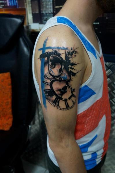 Shoulder Clock Trash Polka Tattoo by Proki Tattoo