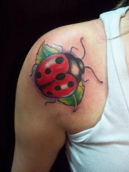 Shoulder Ladybug Tattoo by Mandinga Tattoo