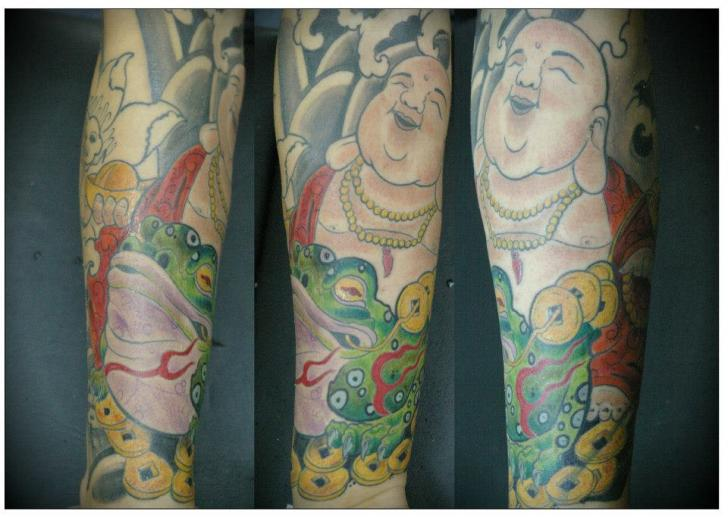 Arm Buddha Frog Tattoo by Salo Tattoo