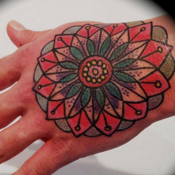Flower Hand Tattoo by Tattoo Tai