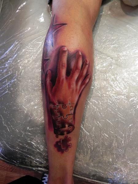 Arm Hand Puzzle Tattoo by Rock Ink