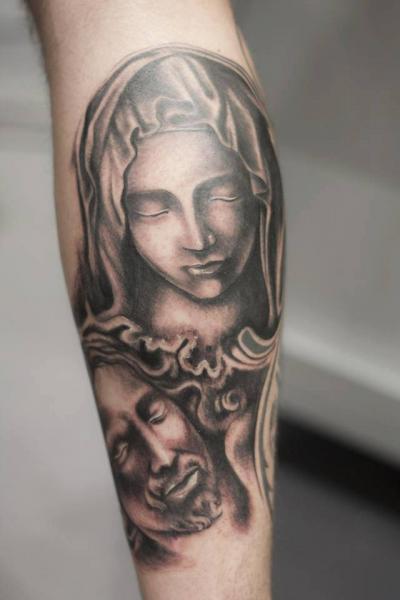 Tatuaje Brazo Religioso por La Mano Zurda