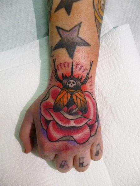 Old School Flower Hand Tattoo by Tattoo Blue Cat