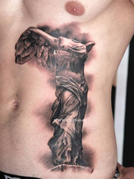 Side Religious Statue Tattoo by V Tattoos