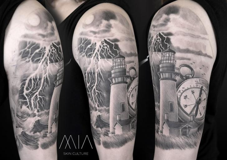 Shoulder Arm Clock Lighthouse Tattoo by Mia Tattoo
