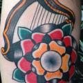 Arm Old School Flower Harp tattoo by North Side Tattooz