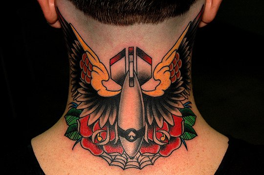 Old School Neck Wings Bomb Tattoo by Jim Sylvia