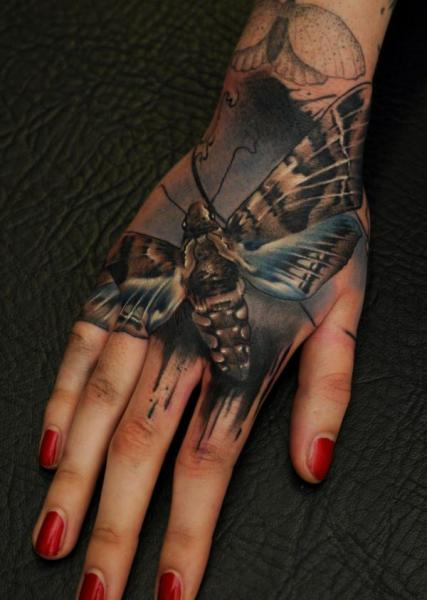 Realistic Hand Moth Tattoo by Vicious Circle Tattoo