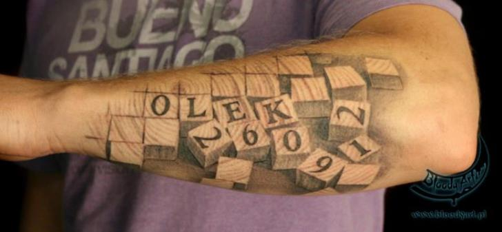 Arm Puzzle Fonts Tattoo by Bloody Art