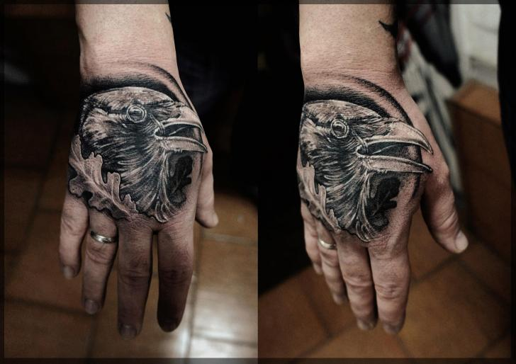 Realistic Hand Crow Tattoo by Pavel Roch