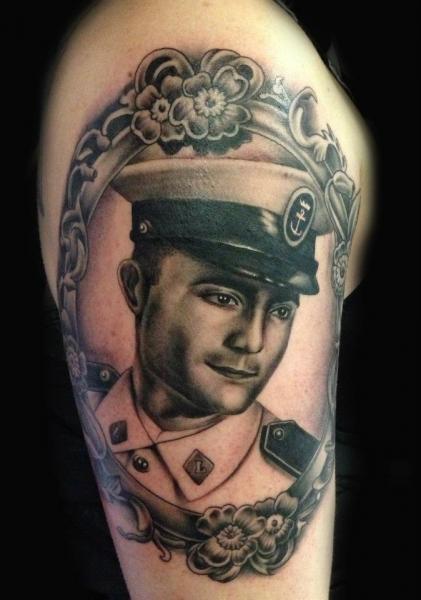 Shoulder Portrait Realistic Medallion Tattoo by Nirvana Tattoo