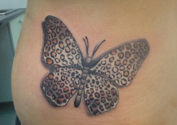 Side Butterfly Tattoo by Nirvana Tattoo