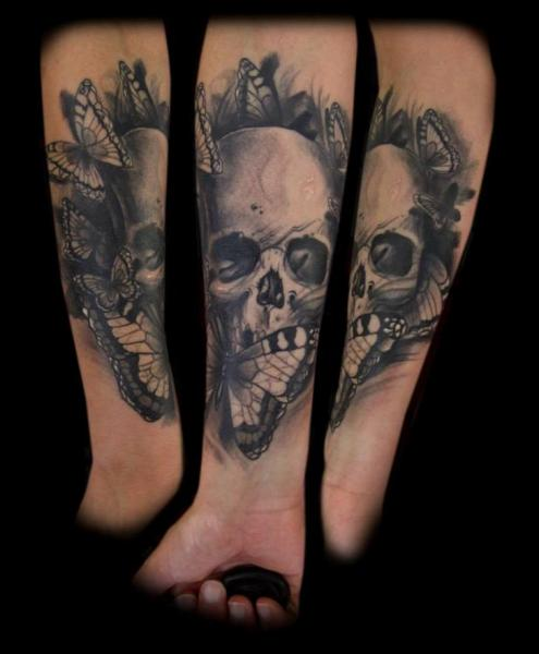 Arm Skull Butterfly Tattoo by Tattoo Chaman