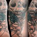 Shoulder Skull Puppet tattoo by Belly Button Tattoo